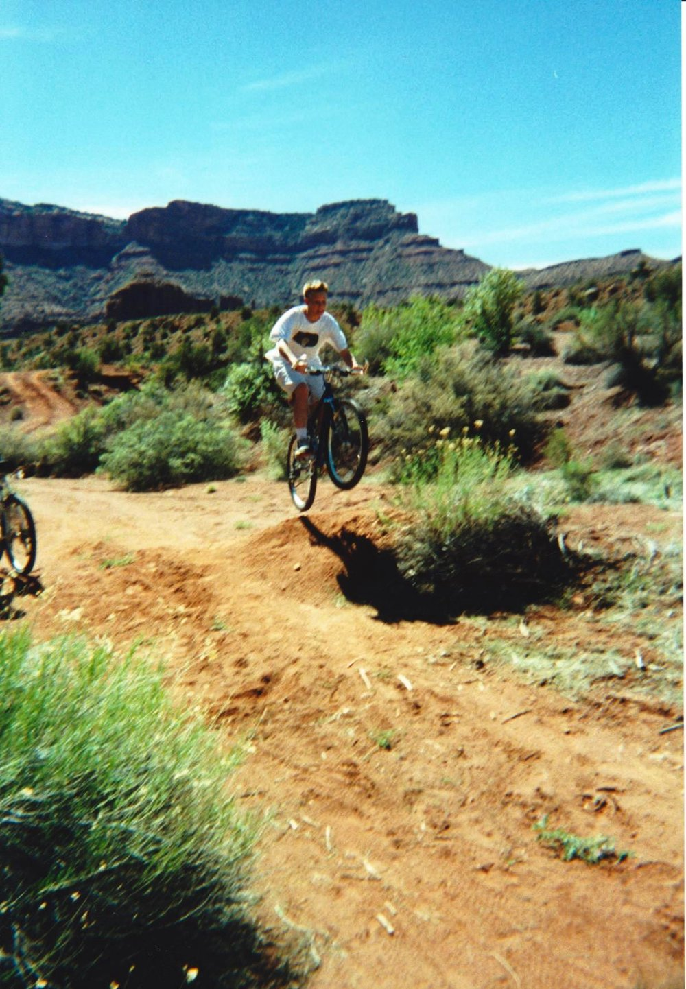 Brett jumping off bike ramp in Moab.jpg