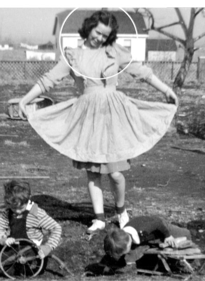 Grandma Kathryn in dress outside with kids.jpg