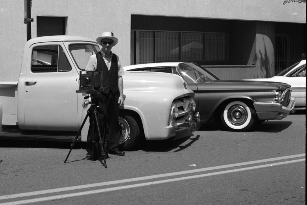 Vintage Photographer at Car Show