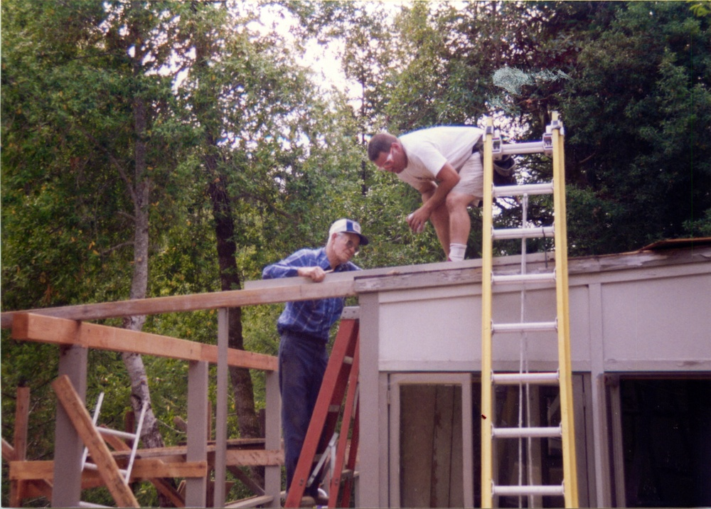 My grandfather and brother replacing the big porch.