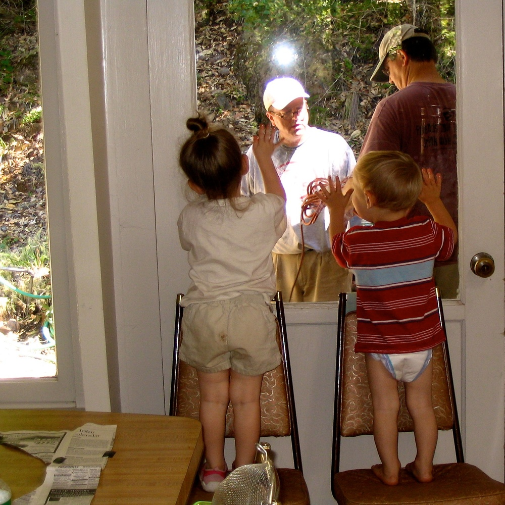 My husband and brother-in-law replacing the roof while my son and niece inspect their work in 2006.