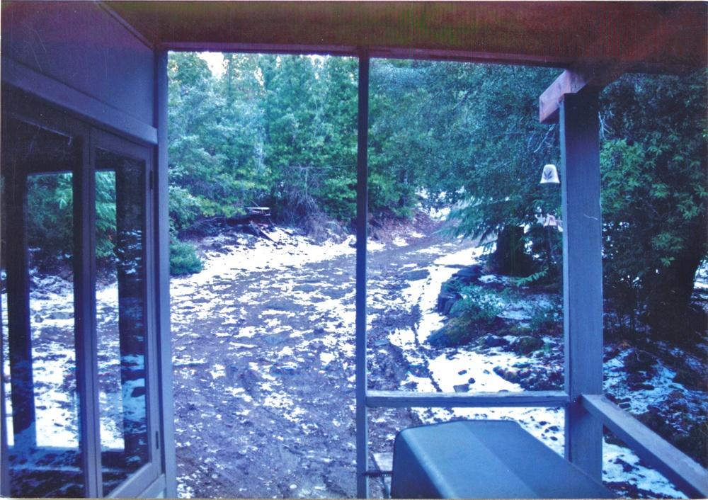 snowy cabin porch.jpg