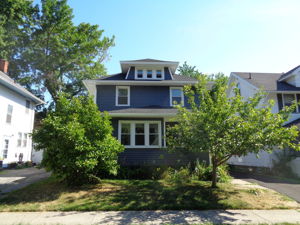Navy Blue Siding 4 Bedroom Home Conveniently Located In Rochester NY Close To Elmwood Bridge.  44 Kingsboro is perfect for University of Rochester Undergrad and Grad Students Seeking Affordable Housing In Rochester NY