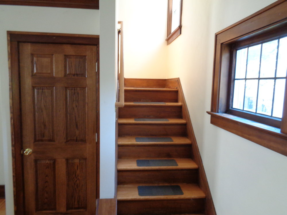 Wood staircase with safety rubber pad student housing in rochester ny