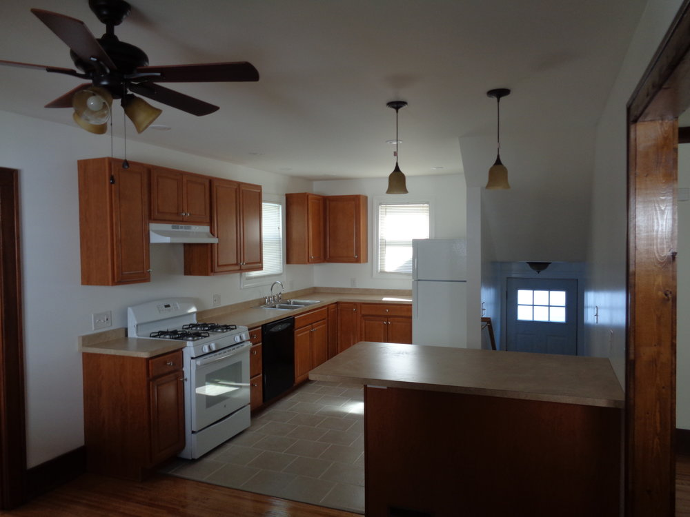 large kitchen with ceiling fan located in rochester ny