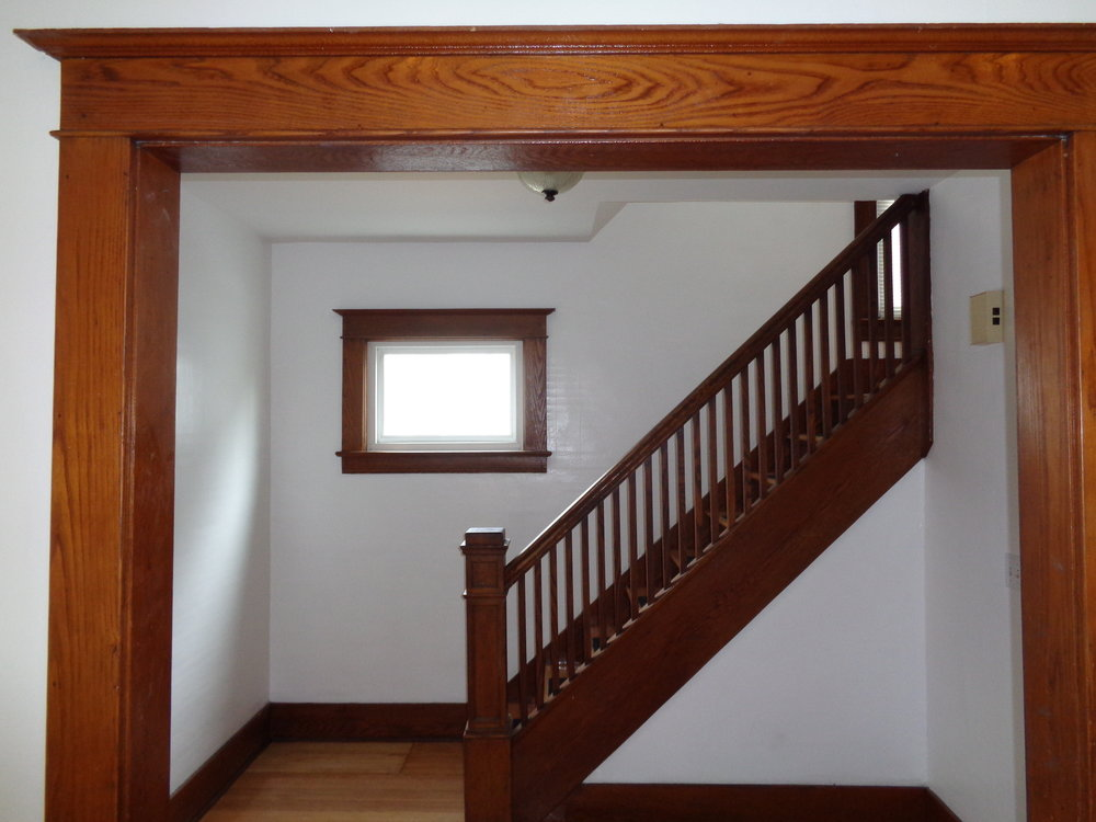 Wood Furnishing Staircase In Home Close To Rochester Institute of Technology
