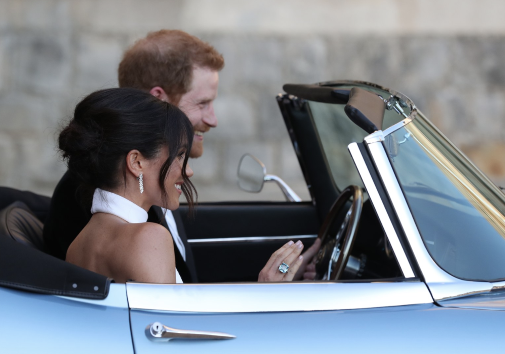 The duke & duchess of sussex  depart  Windsor Castle  for a reception hosted by The Prince of Wales at Frogmore House, in a silver blue  Jaguar E-Type Concept Zero . This vehicle was originally manufactured in 1968, and has since been converted to electric power, est. $4 million.  on meghan: The late  princess diana 's aquamarine ring, STELLA Mccartney halter gown.