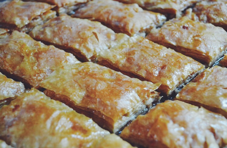 I've made homemade baklava from scratch only once (above) and it is definitely as difficult as it sounds (particularly the dough). Amazing work by this Syrian couple for making baklava on a regular basis and selling it.. not to mention in a foreign country without access to their kitchen and usual supplies!
