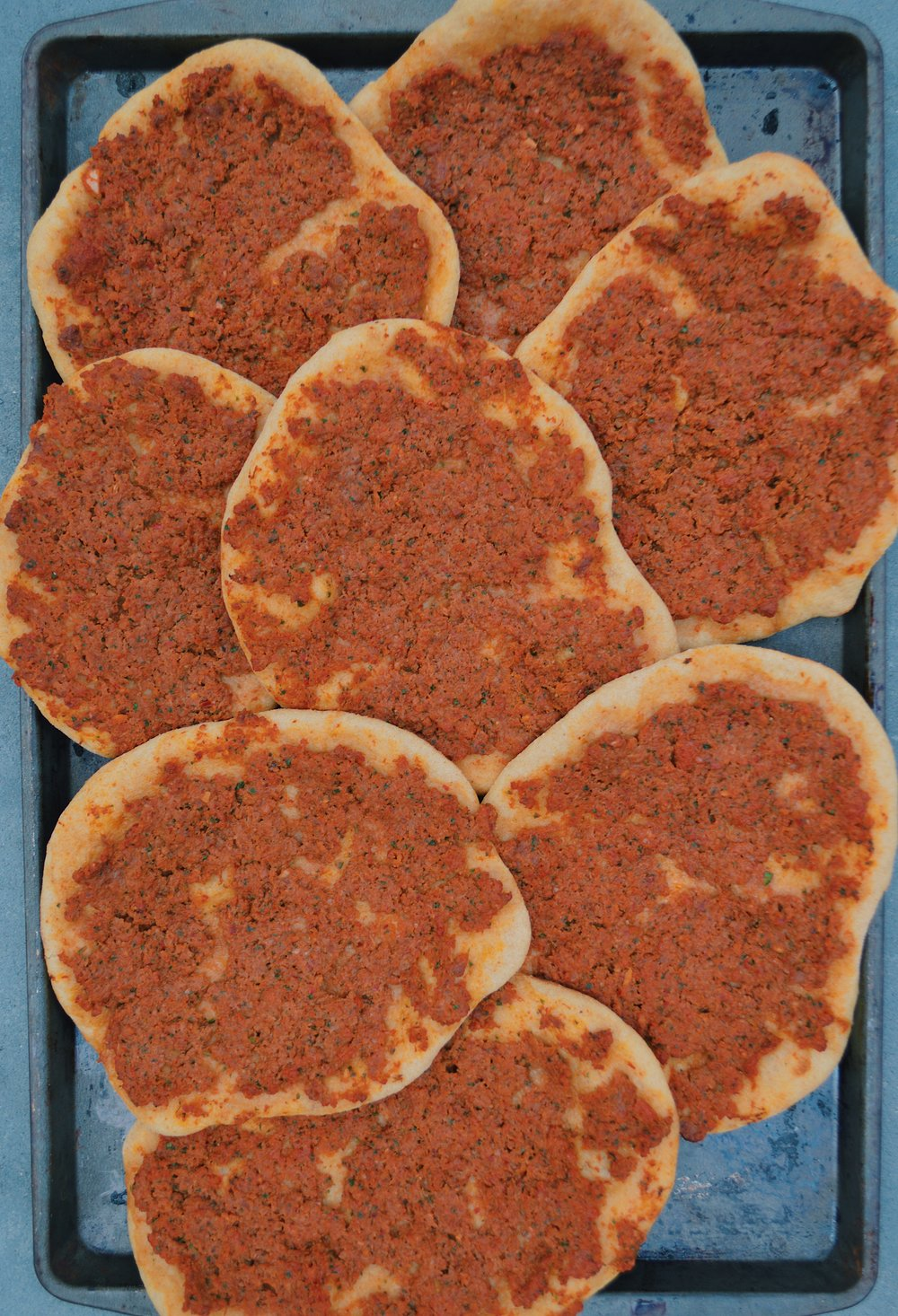 Lahmacun using homemade dough- tastes just as good but does not come out as thin as I would like it to be.