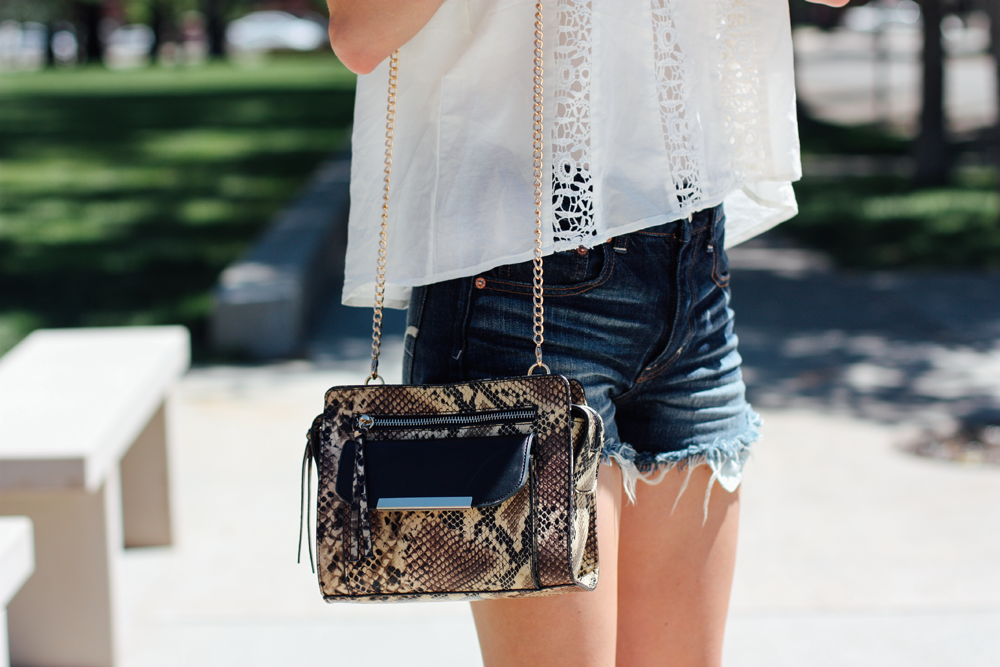 JustFab handbag, American Eagle shorts, and Forever 21 off-the-shoulder blouse via truelane.png
