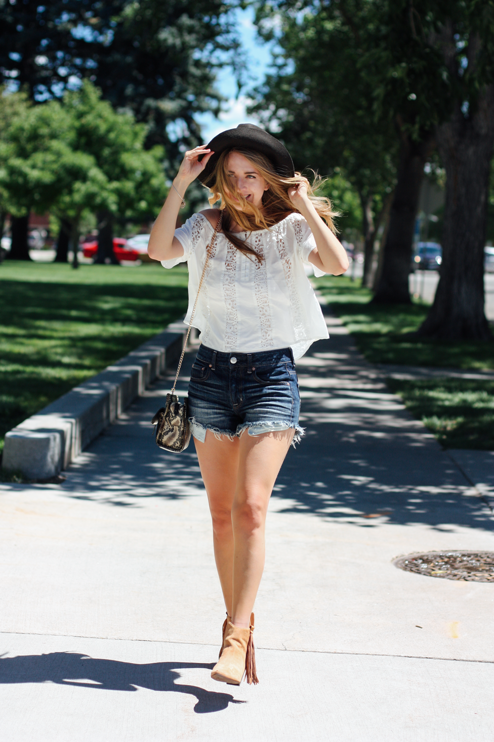 American Eagle hat and denim shorts, Forever 21 off-the-shoulder top, Matisse Footwear Shields booties in Cheyenne, Wyoming via truelane.png