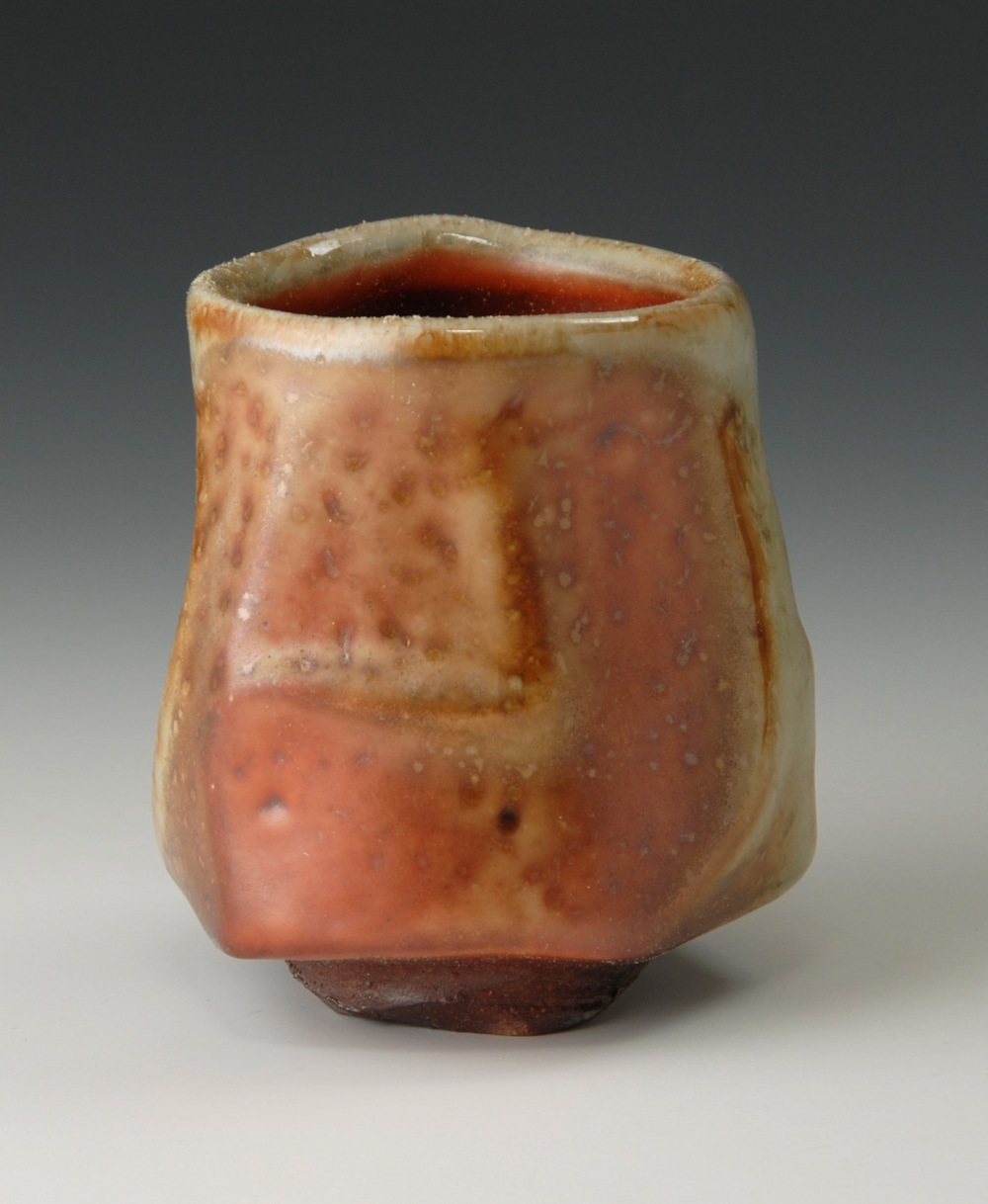 Faceted cup, shino glaze