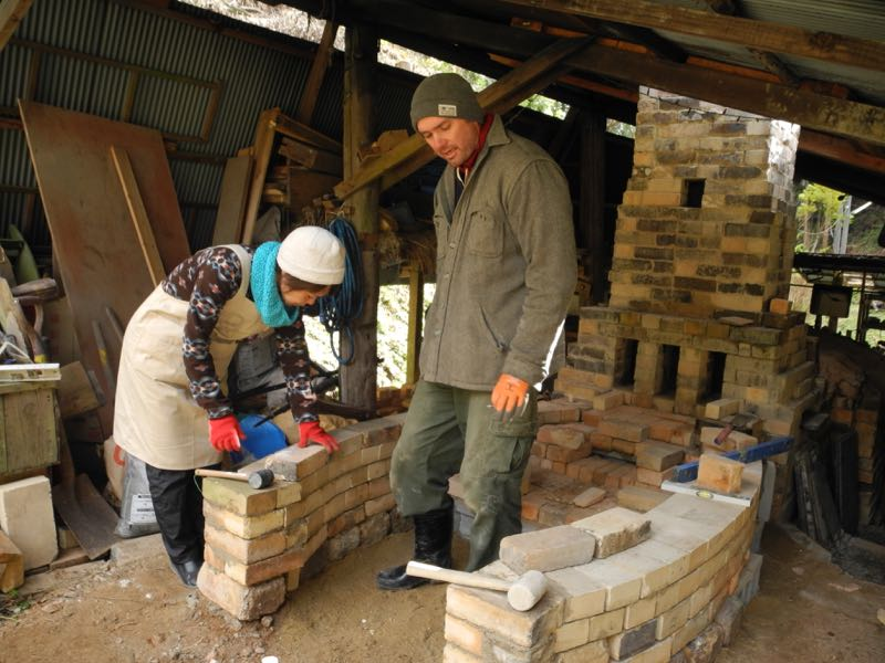 Day 2: Kuni and John building the walls.