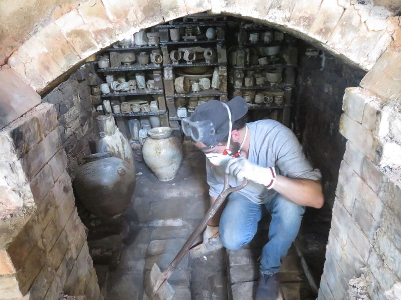 Ty sweeping out the kiln