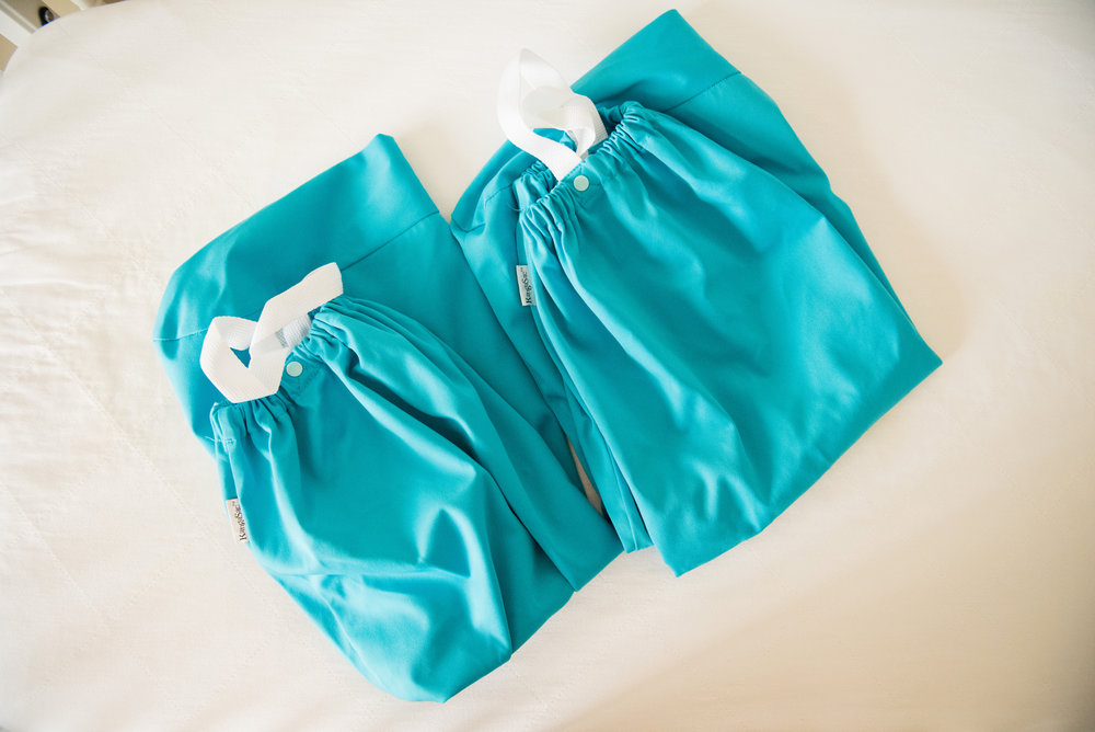 Wet bags are great for traveling, and can continue to be used even when you're done diapering. I love them for swim suits or clothing storage in the car.
