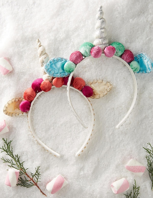 Cutest stocking stuffer ever. Let the Christmas morning photoshoots commence!   Anthropologie Unicorn Headbands  - $24