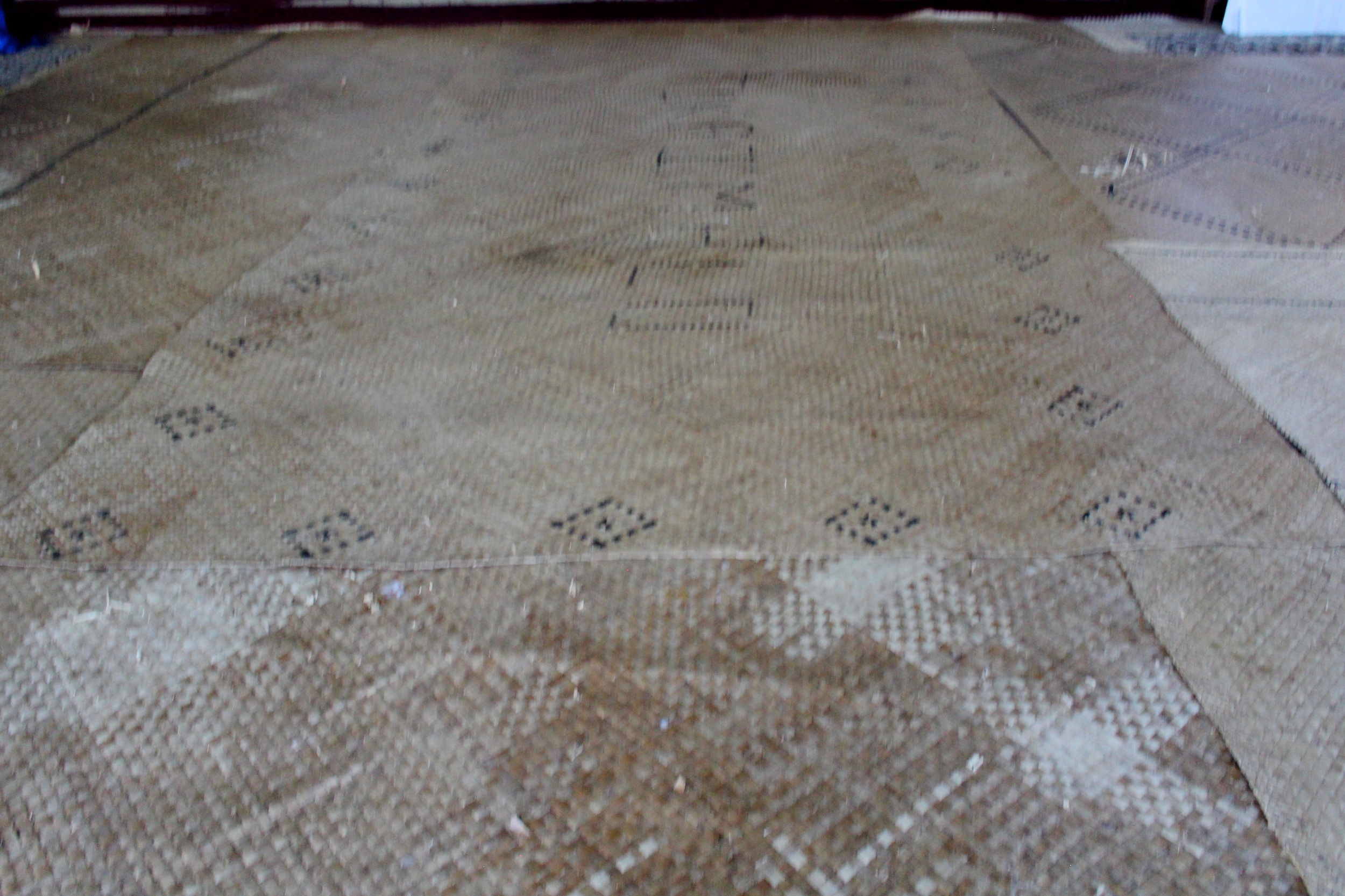 Woven mats covering the floor