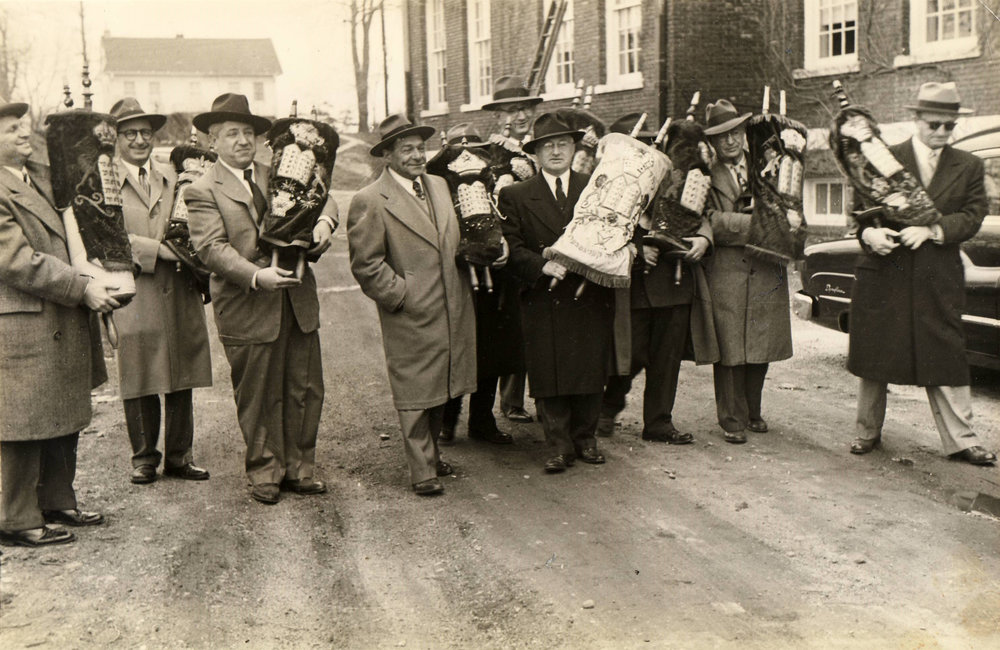Members of the board of directors prepare to carry Torahs brought from the Harlem Home into the main building of the new Hebrew Home situated on an idyllic campus of almost 19 acres overlooking the Hudson River and Palisades. They arrived, along with the Home's 39 residents, on April 17, 1951, just a few days before Passover.