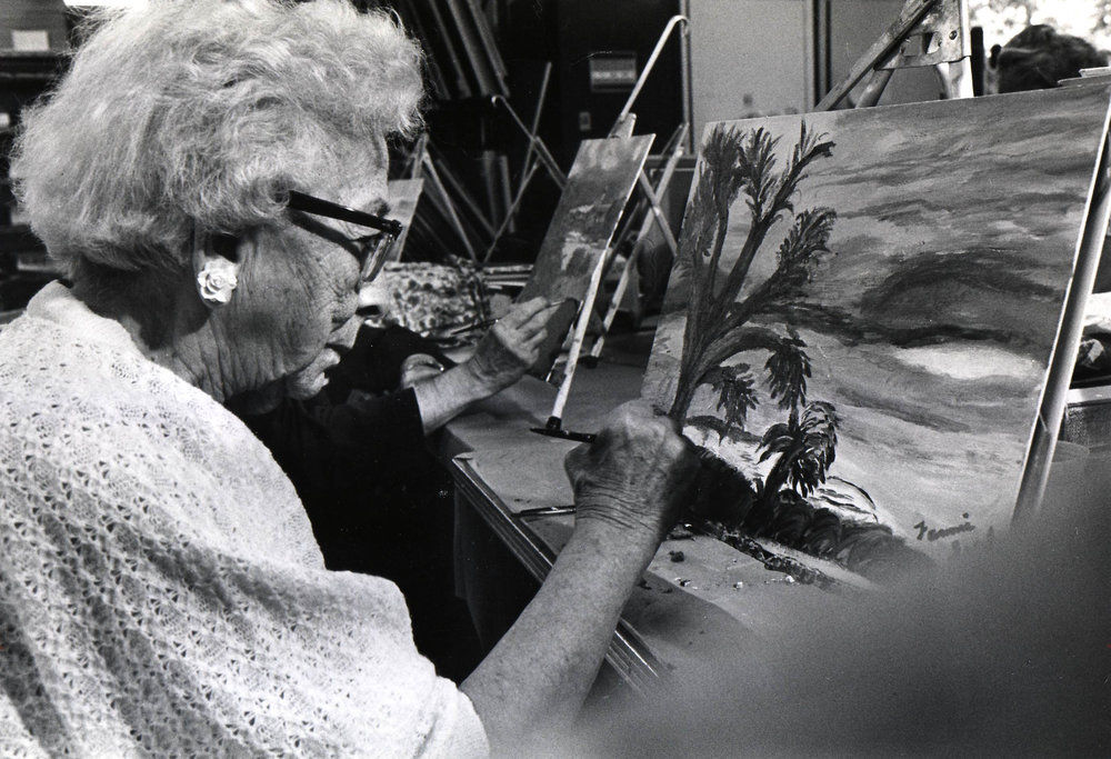 A resident working on a painting in the art studio, ca. 1970s.