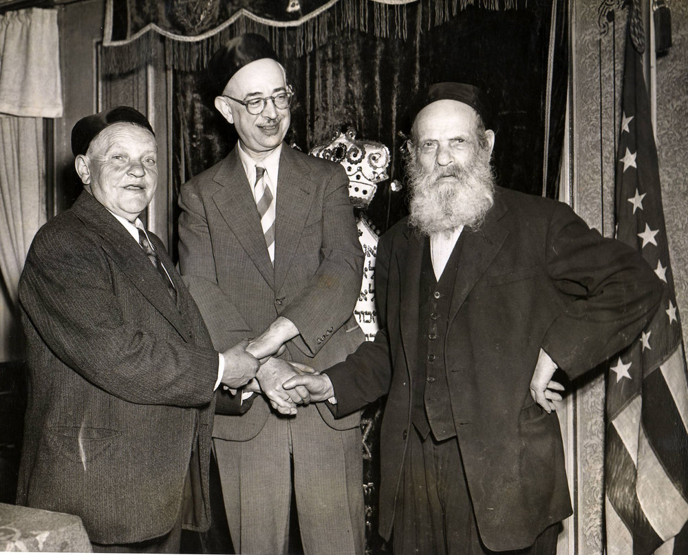 Rabbi Isaac Spira, an immigrant from Palestine, who was the Superintendent and later the Executive Director of the Home from 1920-1953, posed with father and son residents, Isaac Gelbwacks, age 87, and Mendel Gelbwacks, age 66, before 1951.
