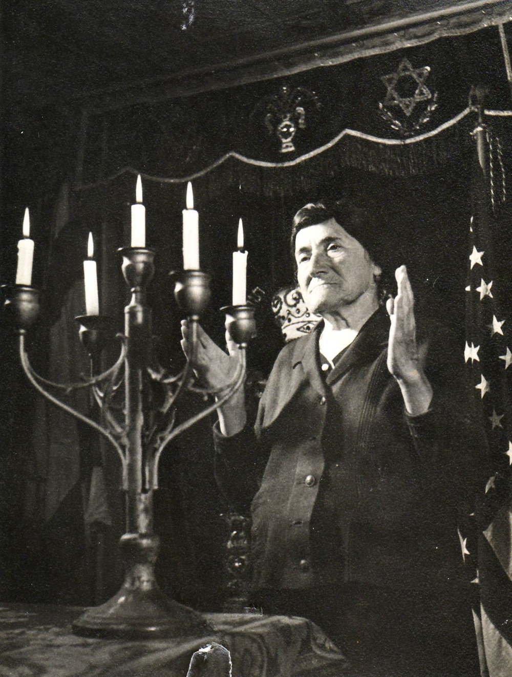 Blessing the Sabbath candles in the Hebrew Home's sanctuary, before 1951.