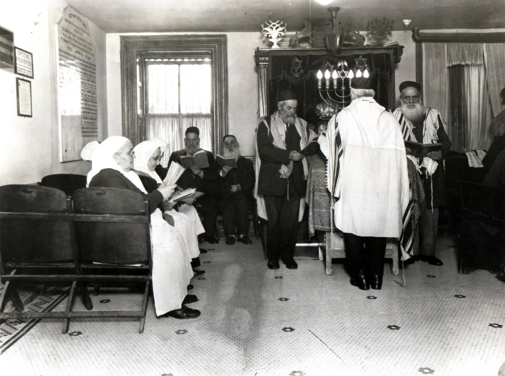 Synagogue services in the early days of the Hebrew Home of Harlem, before 1951.