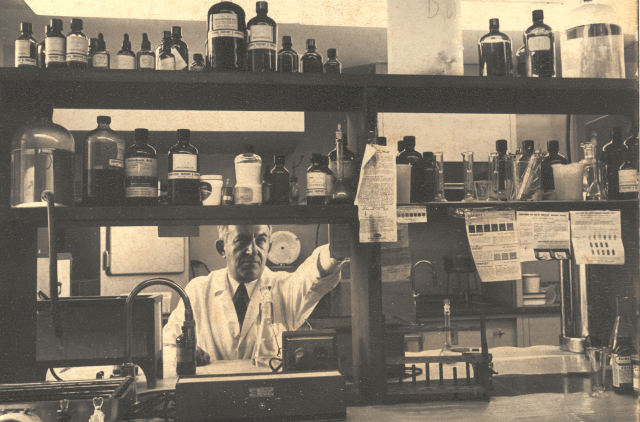 Dr. Norman Frenkiel, Hebrew Home's first medical director, in the Pharmacy, ca. 1960s.