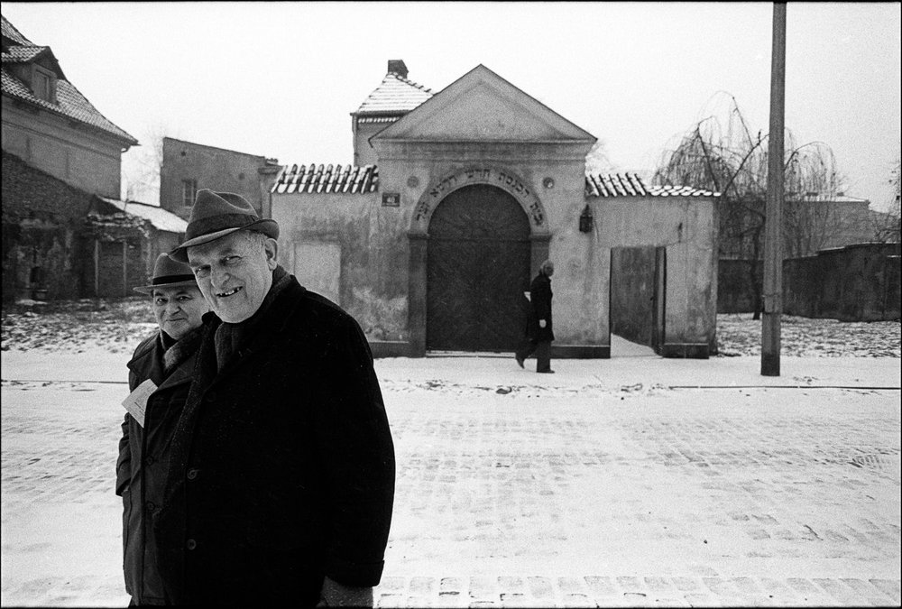 Chuck Fishman,Ludwik Berlinski (left) and Maurycy Jam (right) leaving the Remu Synagogue after the last Saturday service of 1978. Krakow, December 1978. © Chuck Fishman