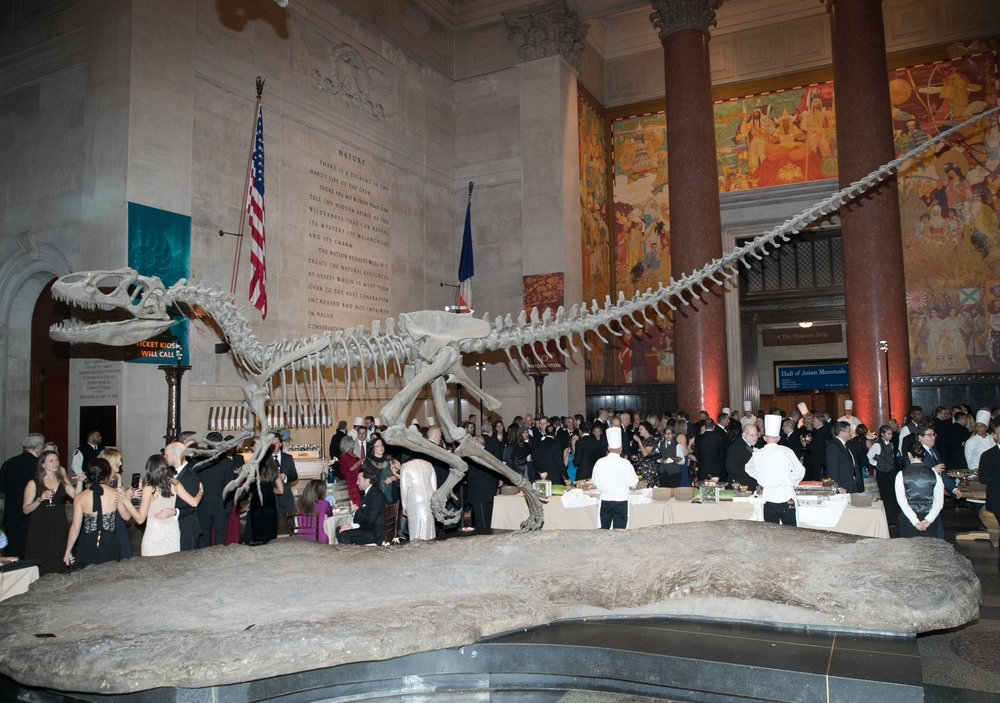 Gala guests enjoy cocktails under the watchful gaze from the majestic Allosaurus skeleton.