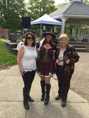 This shot was taken just before the Opening Ceremonies on Festival Day. From right to left, Waltham Mayor Jeannette McCarthy, Downtown Waltham Partnership President Lisa Lorgeree in her full Steampunk splendor, and Kelly Hill, an active Board Member of many Waltham nonprofits.