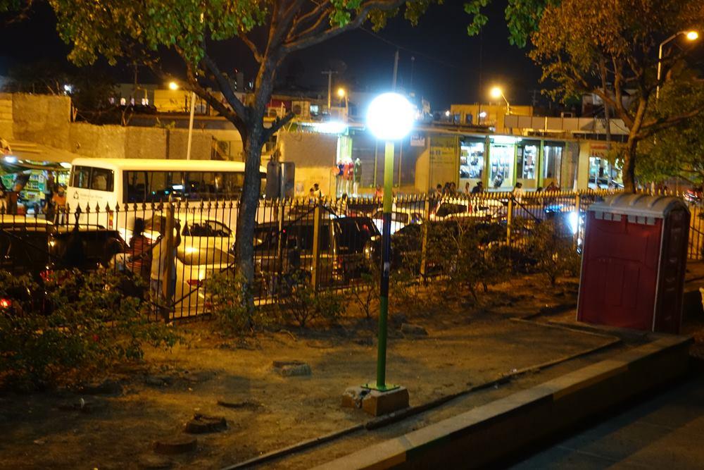 The street behind Mandela park - exhausts fuming, horns blairing