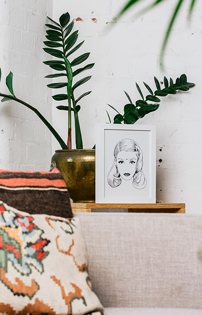 Small framed art and pot plants are a winning combo