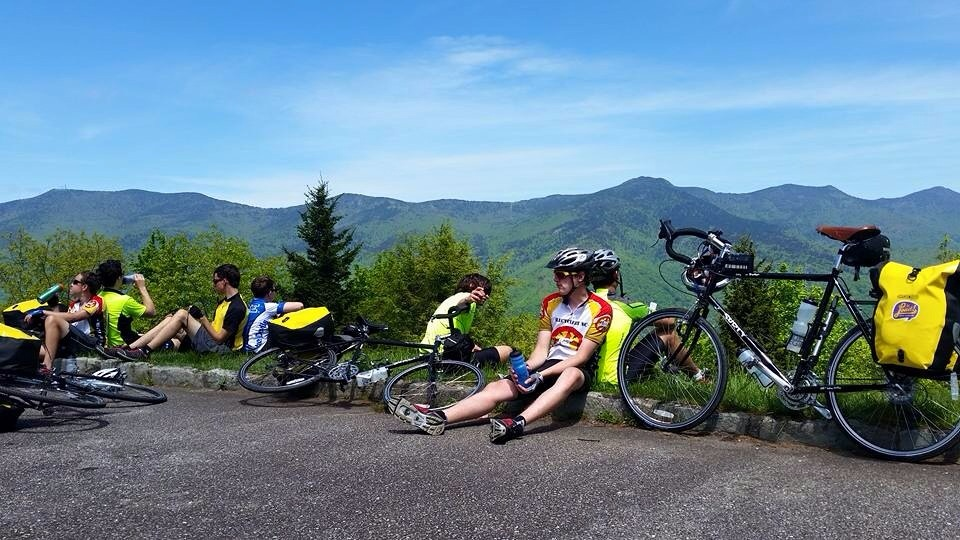 Who needs a camp chair when you can do the lean? Taking a break along the Blueridge Parkway. Mt Mitchell looms in the distant background.