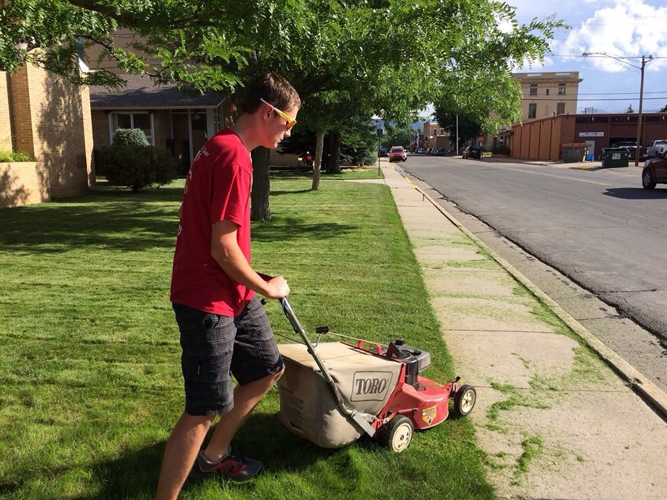 Max, as well as the rest of the crew, mow the lawn at the Lander Methodist Church.