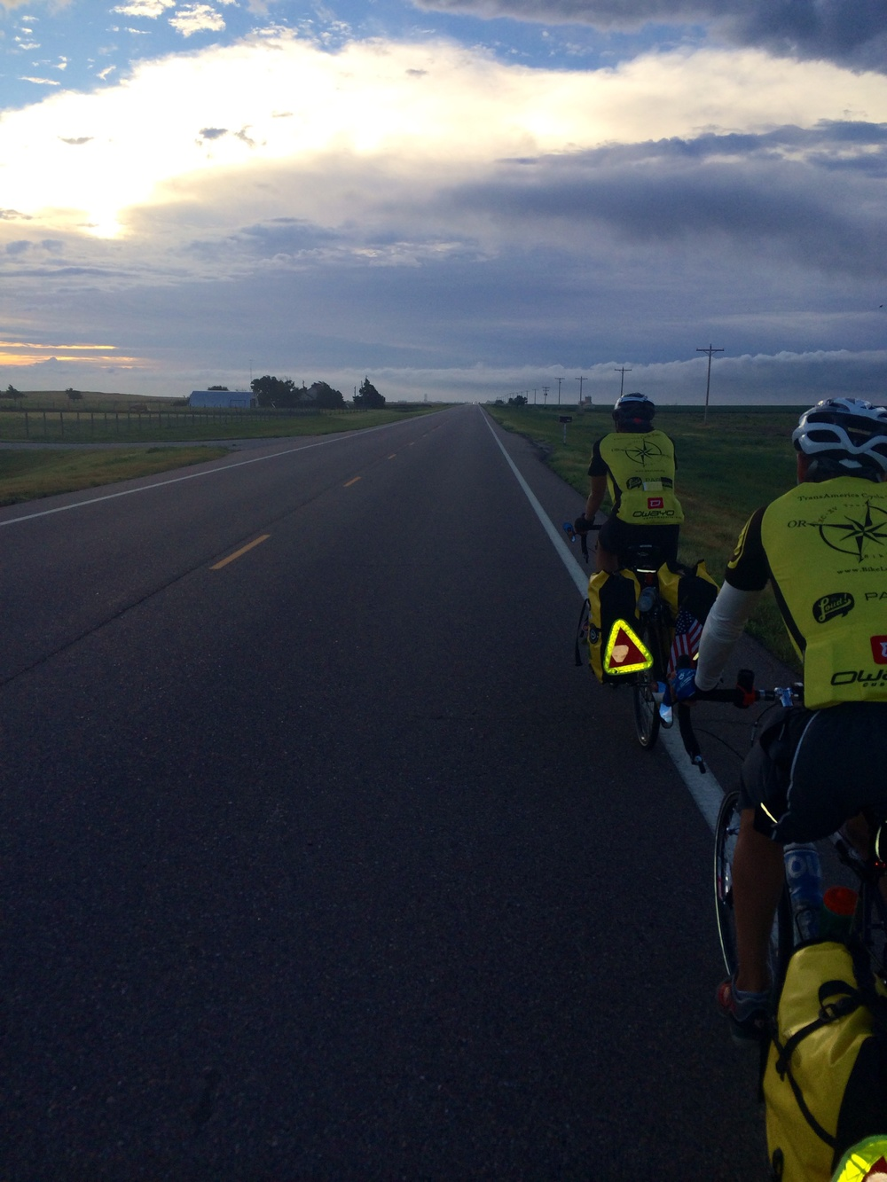 Morning spin class. The crew rolls out across Kansas at dawn in the big ring.