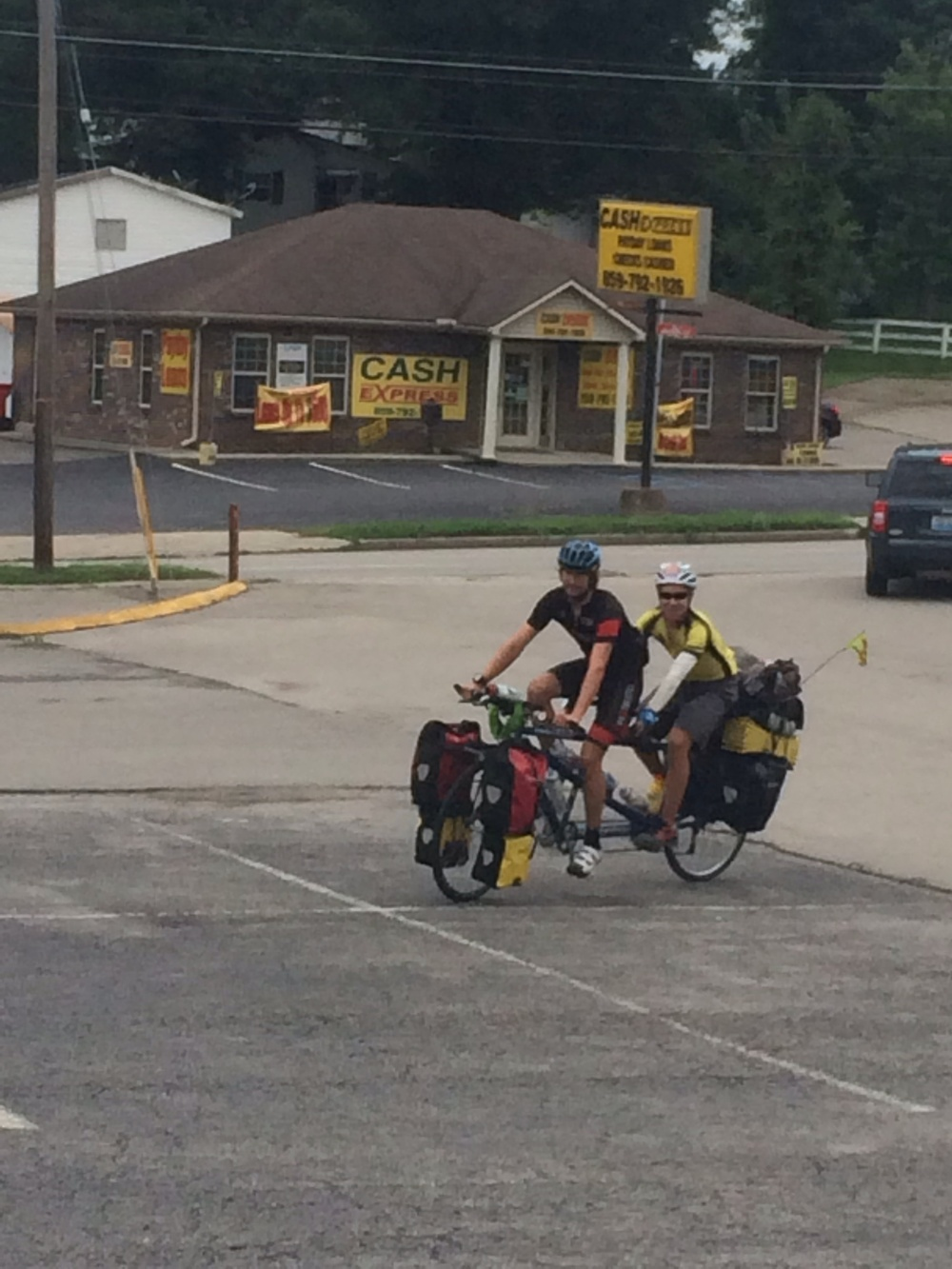 Brian takes a parking lot spin on the tandem with Benja.