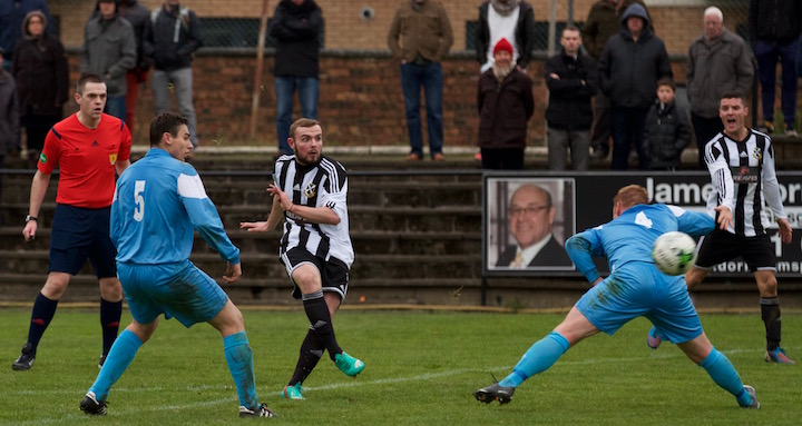 19 year old, Steven Higgins scores a curling strike to put Pollok in the next round of the Scottish Junior Cup.