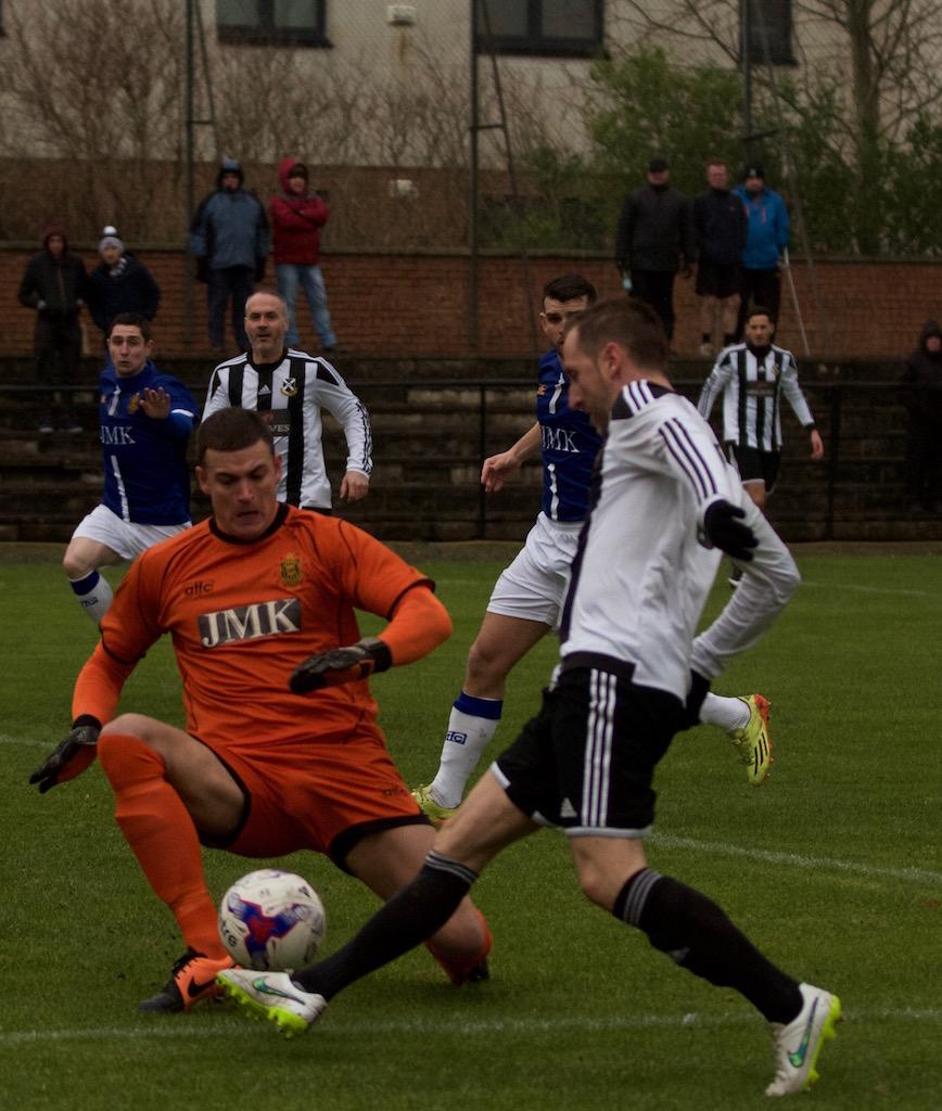 2 - David Winters puts the ball through Andy Leishman's legs copy.jpg