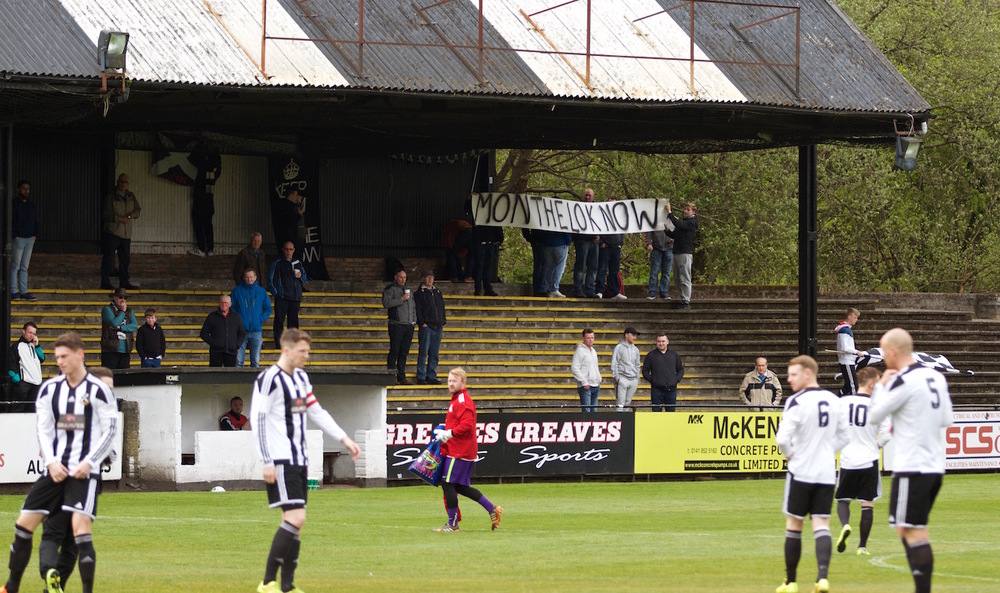 1 - Fans hold up a message to the team copy.jpg