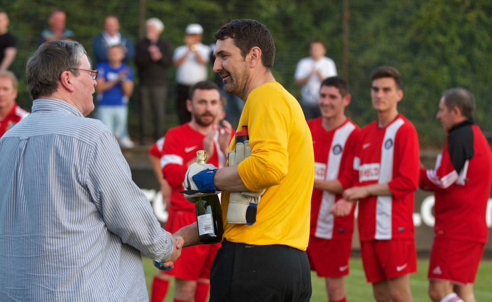 23 - Pollok FC present Port Glasgow goalkeeper with bottle of champagne for his retirement match copy.jpg