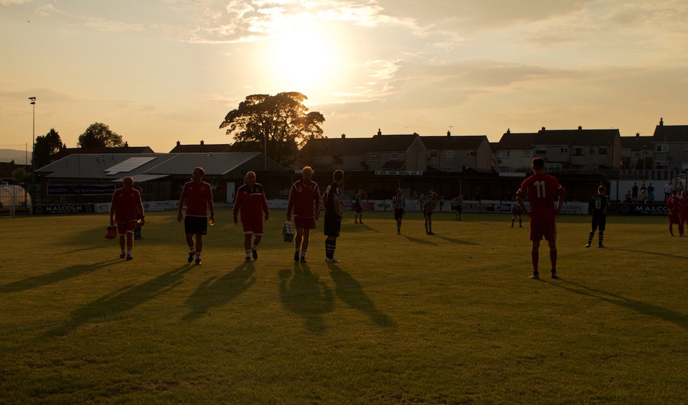 12 - The Pollok management team walk across the Bellsdale Park pitch copy.jpg