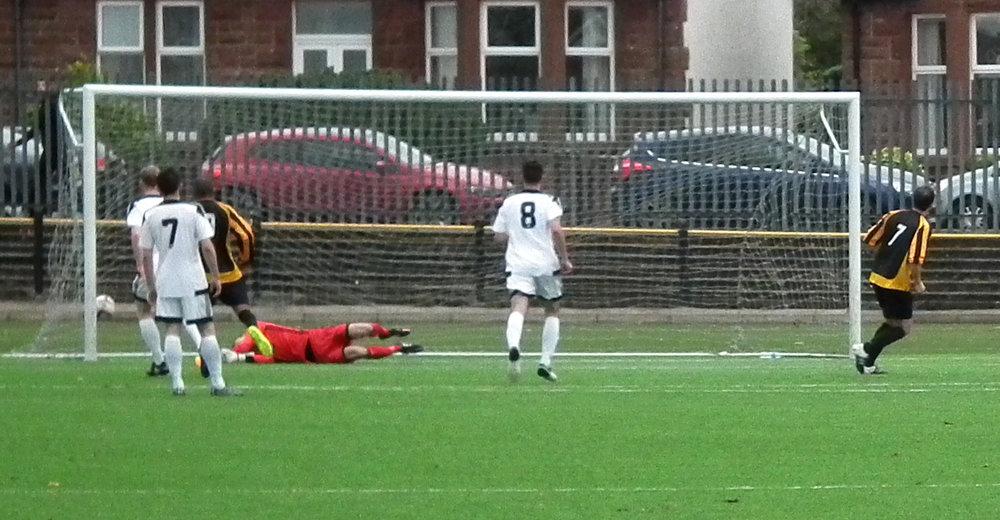 5- Glenn Thomson's penalty nestles in the bottom  corner.JPG