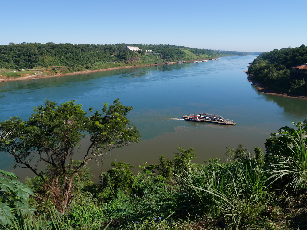 Three borders: The photograph is taken from Argentina; across the Paraná, to the left, is Paraguay; across the Iguazú River, in front to the right, is Brazil.