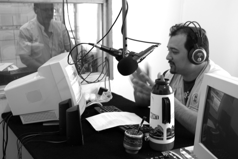 Horacio Valdés conducting a radio program from a studio in Iguazú.