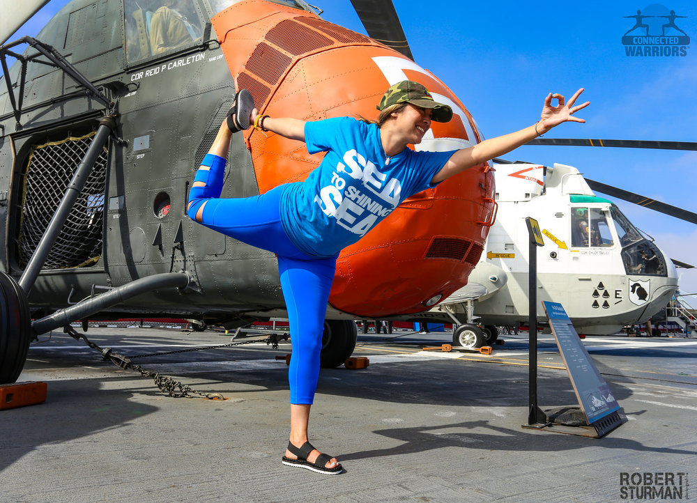 Photo Credit:  Robert Sturman   CONNECTED WARRIORS From Sea to Shining Sea event onboard the USS Midway. Yoga on an aircraft carrier is quite the experience!