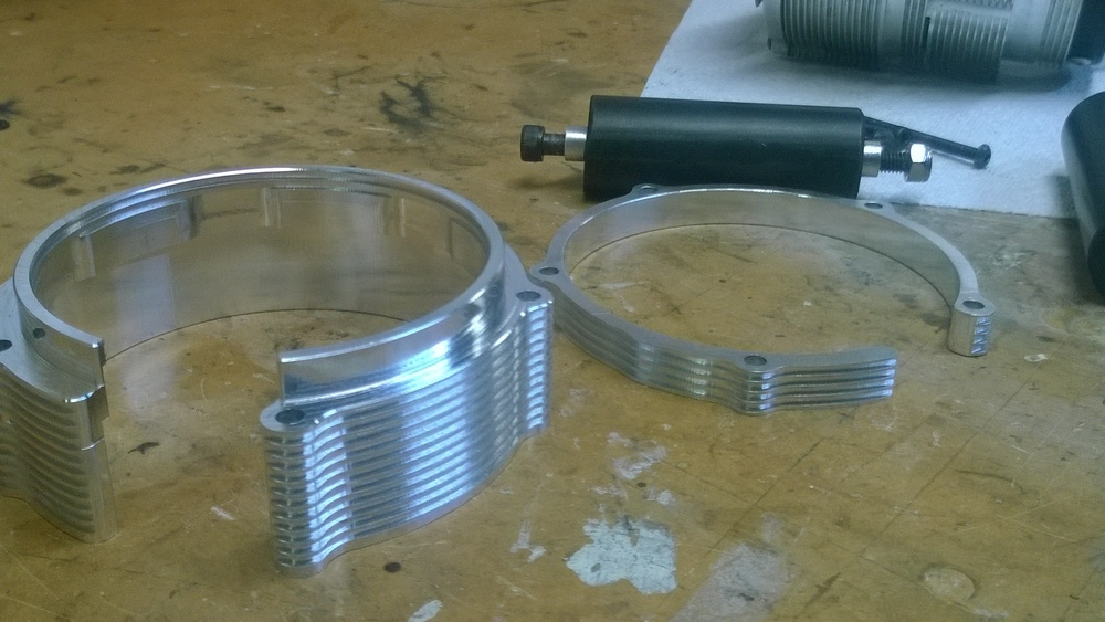 100mm on the left, 83mm on the right. The 100mm is a snug fit over the housing providing a more than adequate brace for the left side plate.