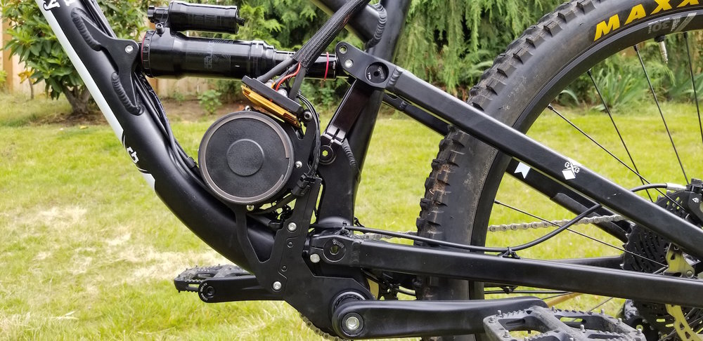 Max fill angular contact bearings inside the frame, suspension axles provide preload and are clamped in place. A very rigid setup.