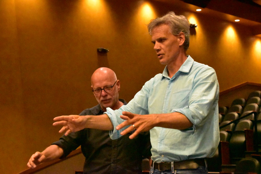 Donald coaching conductor John Rommerein during a conductor's week session