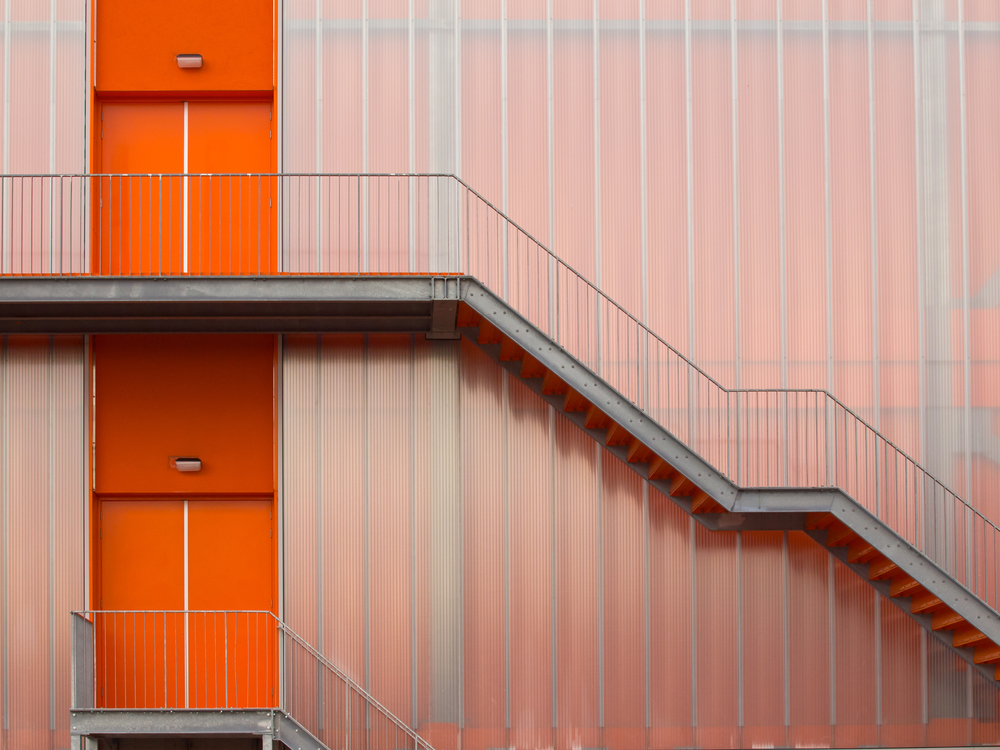 stock-photo-fire-escape-stairs-on-the-outside-of-a-modern-sports-hall-189267179.jpg