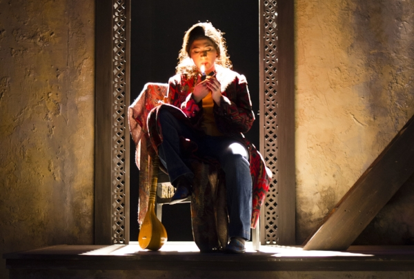 Kat Lozano in the university workshop production of  The Orange Garden . Photo and lighting design by Kate Ducey.